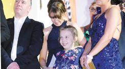 Emily receiving her award with Jamie-Lee