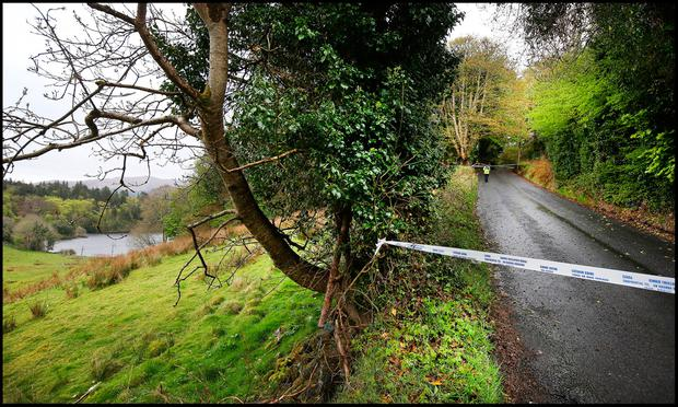 Gardai at the scene at Hollywell Road alongside Lough Gill in Sligo where a body was recovered. Pic Steve Humphreys