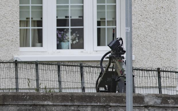 Gardai and Army bomb disposal unit make safe a suspect device in a garden of a house in Kimmage, Dublin. Picture:Arthur Carron