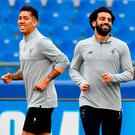 Liverpool's Roberto Firmino and Mohamed Salah in relaxed mood during Liverpool's training session in Rome's Olympic Stadium last night. Photo: Ettore Ferrari/ANSA via AP