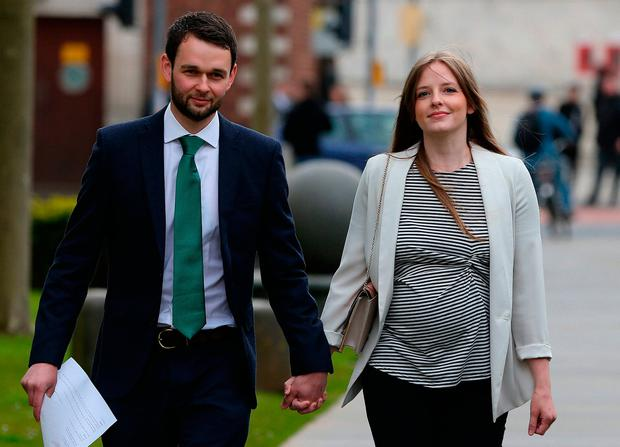 Daniel McArthur and his wife Amy arrive at the Royal Courts of Justice in Belfast. Photo: PA