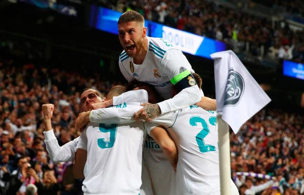 Soccer Football - Champions League Semi Final Second Leg - Real Madrid v Bayern Munich - Santiago Bernabeu, Madrid, Spain - May 1, 2018 Real Madrid's Karim Benzema celebrates scoring their second goal with team mates REUTERS/Michael Dalder