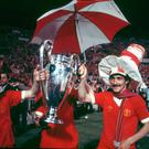 Terry McDermott celebrate with the trophy after their victory over Borussia Moenchengladbach in the European Cup Final at the Olympic Stadium in Rome, 25th May 1977. Photo: Allsport/Getty Images