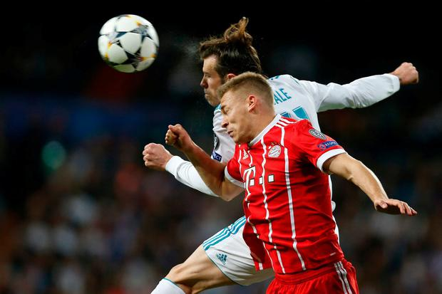 Real Madrid's Gareth Bale and Bayern's Joshua Kimmich challenge for the ball. Photo: Francisco Seco/AP Photo