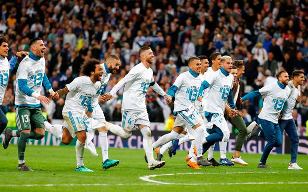 Real Madrid celebrate after the match. Photo: Kai Pfaffenbach/Reuters