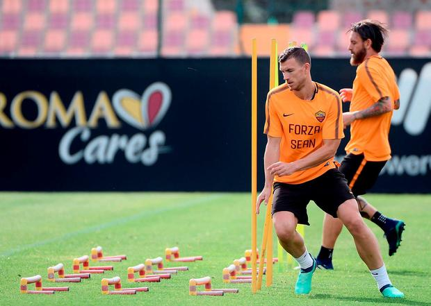 Edin Dzeko and Daniele De Rossi take part in Roma's training session yesterday. Photo: Filippo Monteforte/AFP/Getty