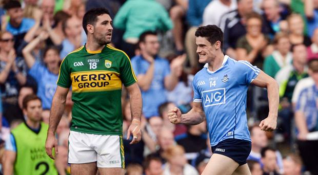 BLUE RULE: Dublin's Diarmuid Connolly celebrates after kicking a superb left-footed, late point to put Jim Gavin's men two points ahead, as Kerry's Bryan Sheehan looks on in disbelief, during the 2016 All-Ireland SFC semi-final
