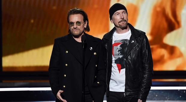 Recording artists Bono (L) and The Edge of music group U2 speak onstage during the 60th Annual GRAMMY Awards at Madison Square Garden on January 28, 2018 in New York City. (Photo by Kevin Winter/Getty Images for NARAS)