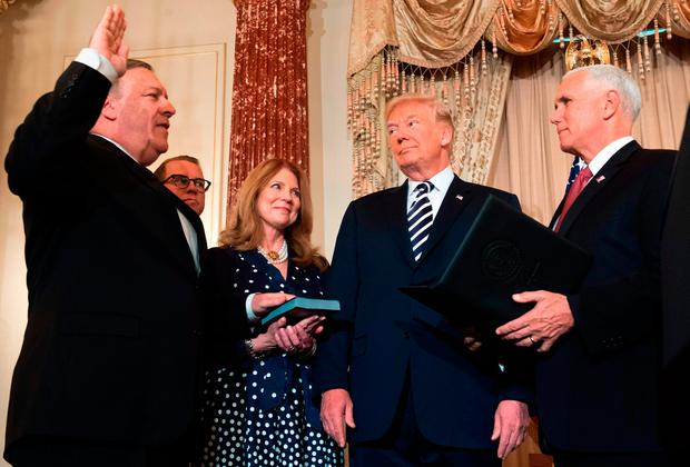 US President Donald Trump watches Mike Pompeo take the oath during his ceremonial swearing-in as US Secretary of State, as wife Susan Pompeo, son Nick Pompeo and US Vice President Mike Pence, right, look on. Photo: SAUL LOEB/AFP/Getty Images