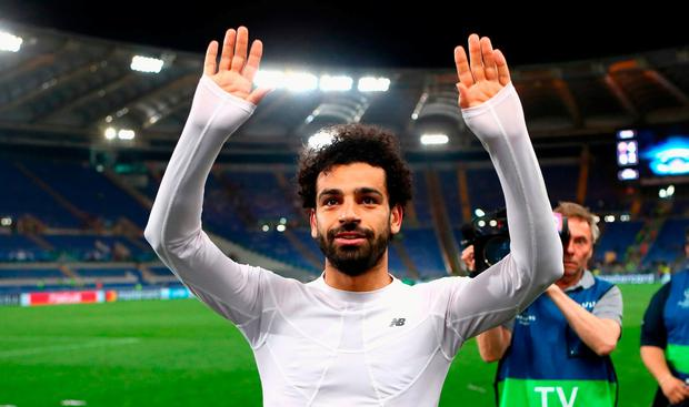 Mohamed Salah of Liverpool celebrates after the full time whistle as Liverpool qualify for the Champions League Final during the UEFA Champions League Semi Final Second Leg match between A.S. Roma and Liverpool at the Stadio Olimpico