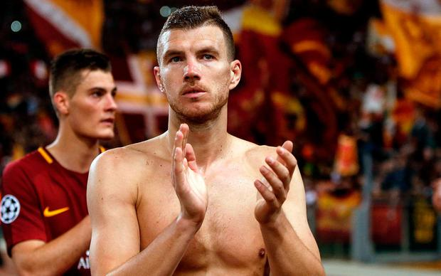 A disappointed Edin Dzeko applauds supporters at the end of the game
