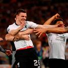 Liverpool's Andrew Robertson and Dejan Lovren celebrate after the match. Action Images via Reuters/John Sibley