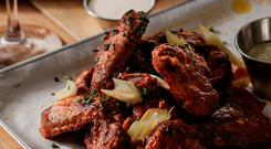 Spicy smoked chicken wings. Photo: Al Higgins