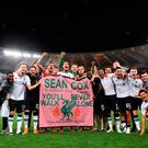 Liverpool celebrate reaching the Champions League Final, with a banner for fan Sean Cox during the UEFA Champions League, Semi Final, Second Leg at the Stadio Olimpico, Rome. Steven Paston/PA Wire