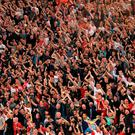 Liverpool's fans celebrates their victory at the end of the UEFA Champions League semi-final second leg football match AS Roma vs Liverpool FC at the Stadio Olimpico in Rome on May 2, 2018. / AFP PHOTO / Alberto PIZZOLIALBERTO PIZZOLI/AFP/Getty Images