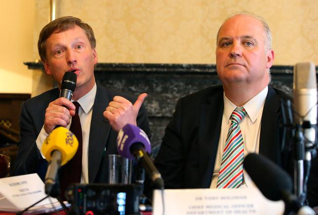 Head of HSE cancer services Dr Jerome Coffey (left) and Department of Health chief medical officer Dr Tony Holohan at a briefing about the cervical cancer scandal at the Royal College of Physicians in Dublin yesterday. Photo: Damien Eagers