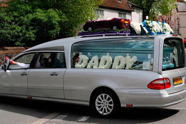 The funeral cortege of burglar Henry Vincent, who was stabbed by a pensioner after breaking in to his home leaves St Marys Church in St Mary Cray, Kent. Gareth Fuller/PA Wire