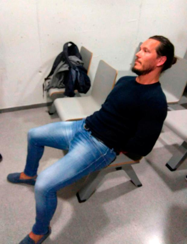 Handout photo taken from the Twitter page of the National Crime Agency @NCA_UK of Jamie Acourt, one of Britain's most wanted fugitives who has been captured by armed officers in Barcelona. @NCA_UK/Twitter/PA Wire