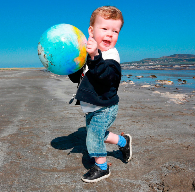 Two-year-old Ethan Emmett from Clare Hall plays on Dollymount Strand