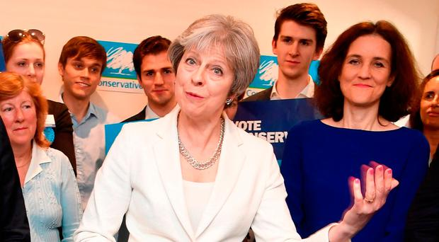 May to push for hard Brexit after election gains
