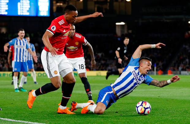 Brighton's Anthony Knockaert goes down in the penalty area after a challenge from Manchester United's Anthony Martial. Photo: Reuters/Paul Childs