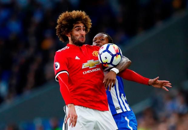 Manchester United's Marouane Fellaini in action with Brighton's Gaetan Bong. Photo: Reuters
