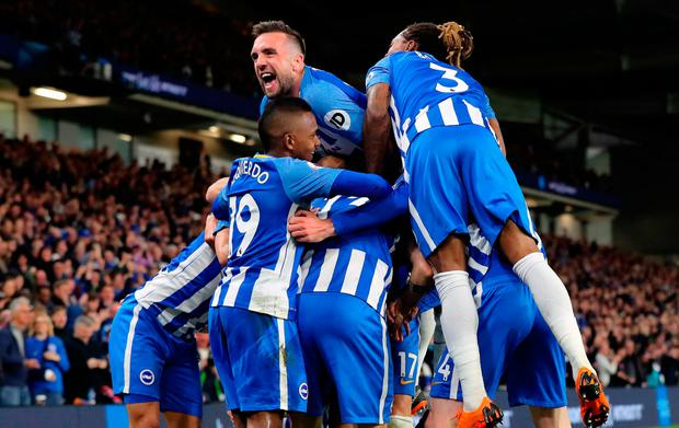 Shane Duffy gets on top of Brighton's celebrations after the winner from Pascal Gross (hidden) last night. Photo credit: Gareth Fuller/PA Wire