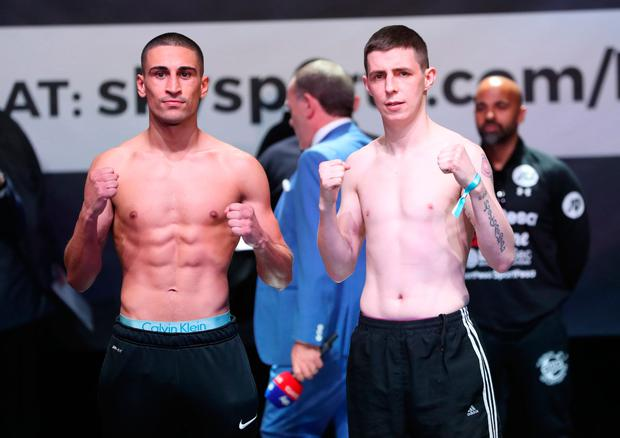 FACE-OFF: Jordan Gill and Carl McDonald weigh in at London's O2 Arena yesterday.