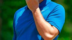 Rory McIlroy reacts to a putt on the first hole