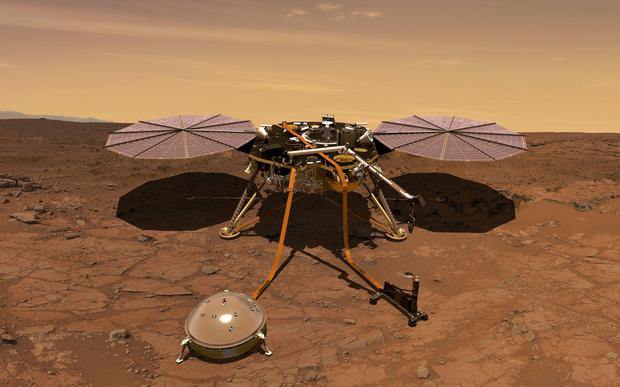 FILE PHOTO: The Mars InSight probe is shown in this artist's rendition operating on the surface of Mars, due to lift off from Vandenberg Air Force Base, California, U.S. on May 5, 2018 in this image obtained on May 3, 2018. NASA/ Handout via REUTERS/File Photo