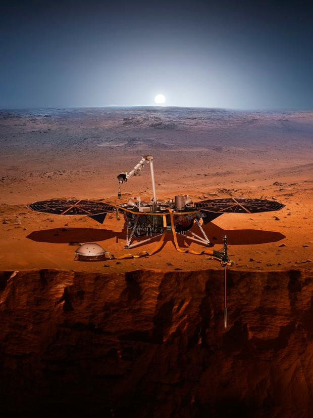 This illustration made available by NASA in 2018 shows the InSight lander drilling into Mars. InSight, short for Interior Exploration using Seismic Investigations, Geodesy and Heat Transport, is scheduled to launch from Vandenberg Air Force Base on Saturday, May 5, 2018, and land on Mars six months later. (NASA via AP)