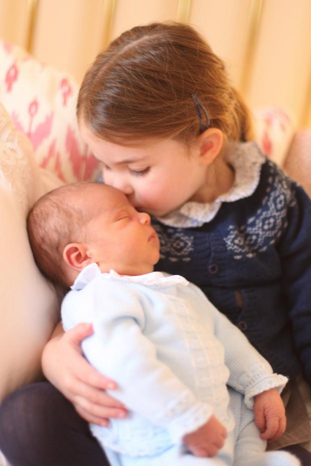 Handout photo dated the 02/05/18 released by the Duke and Duchess of Cambridge of Princess Charlotte with her brother Prince Louis taken by the Duchess of Cambridge on Princess Charlotte's third birthday at Kensington Palace, London. Duchess of Cambridge/PA Wire. Embargoed to 00:01 May 6