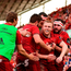 Keith Earls of Munster is congratulated by teammates