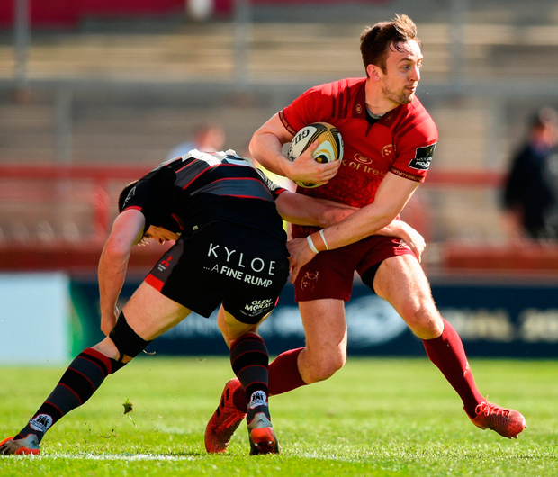 Munster's Darren Sweetnam is tackled by Edinburgh's Blair Kinghorn. Photo: David Fitzgerald/Sportsfile