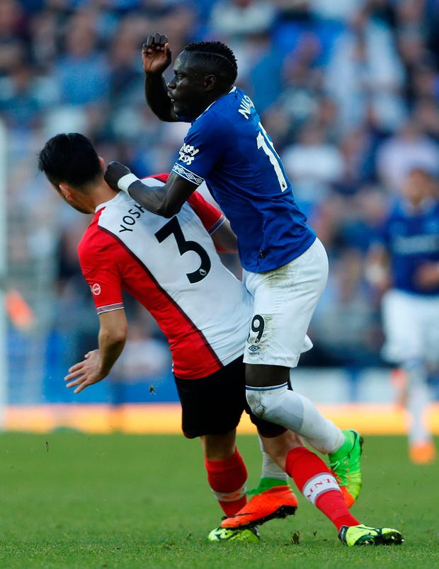 Southampton's Maya Yoshida fouls Everton's Oumar Niasse before being shown a second yellow card and sent off. Photo: Lee Smith/Reuters