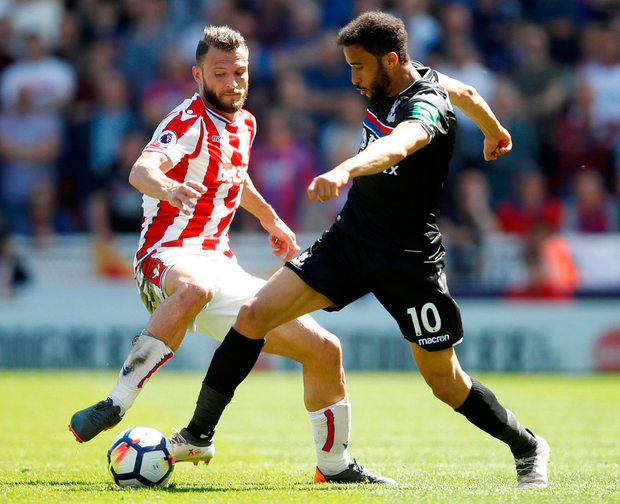 Crystal Palace's Andros Townsend battles for the ball with Stoke City's Erik Pieters. Photo: Carl Recine/Reuters