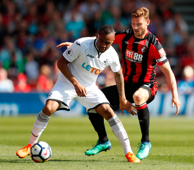 Swansea City's Jordan Ayew in action against Bournemouth's Simon Francis. Photo: Matthew Childs/Reuters