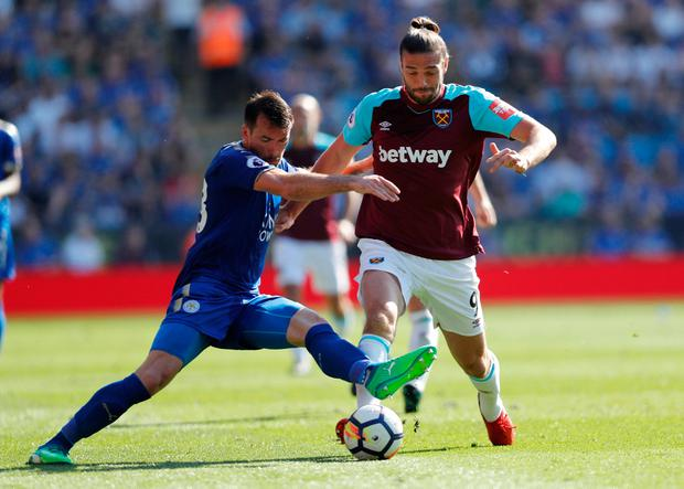 Leicester City's Christian Fuchs battles with West Ham United's Andy Carroll. Photo: Darren Staples/Reuters