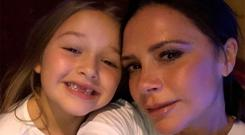 Harper Beckham and her mother Victoria pose for the camera