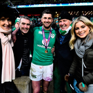 Rob Kearney of Ireland celebrates with his family, from left, mother Siobhan, brother Richard, father David and girlfriend Jess Reddan