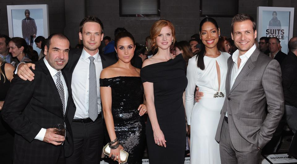 NEW YORK, NY - JUNE 12: (L-R) Rick Hoffman, Patrick J. Adams, Meghan Markle, Sarah Rafferty, Gina Torres and Gabriel Macht of Suits attend USA Network and Mr Porter.com Present
