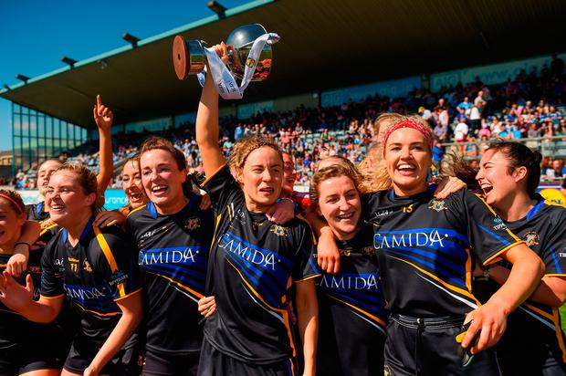 Tipperary captain Samantha Lambert celebrates with teammates