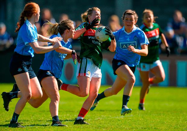 Fiona McHale of Mayo in action against Dublin's, from left, Lauren Magee, Martha Byrne, and Leah Caffrey