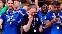 Neil Warnock joins his Cardiff City players as they celebrate after clinching promotion. Photo credit: Simon Galloway/PA Wire.