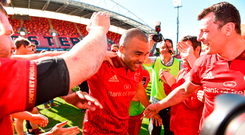 Simon Zebo of Munster is applauded off the field by teammates as he says farewell to the Thomond Park after Munster's victory over Edinburgh on Saturday. Photo: Sam Barnes/Sportsfile