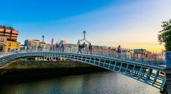 A view of Dublin's Ha'penny Bridge, an iconic landmark in a city that has many hidden gems, including Marsh's Library and the Iveagh Gardens
