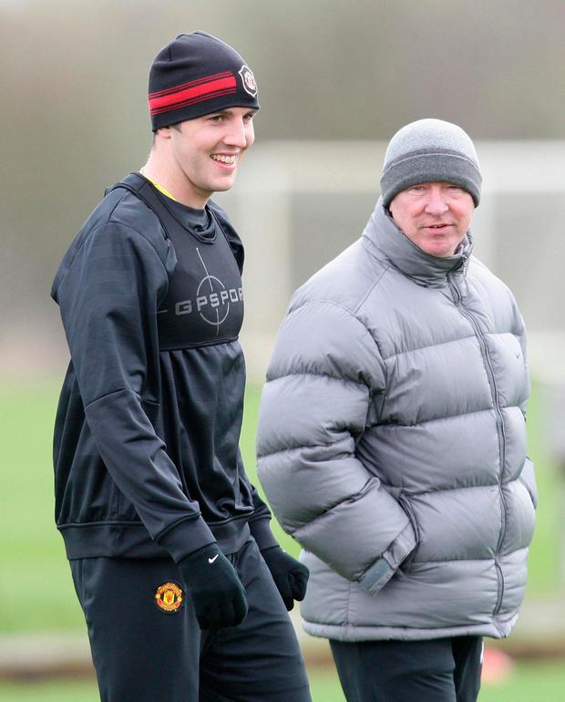 Ferguson in training with John O'Shea. Photo by Manchester United