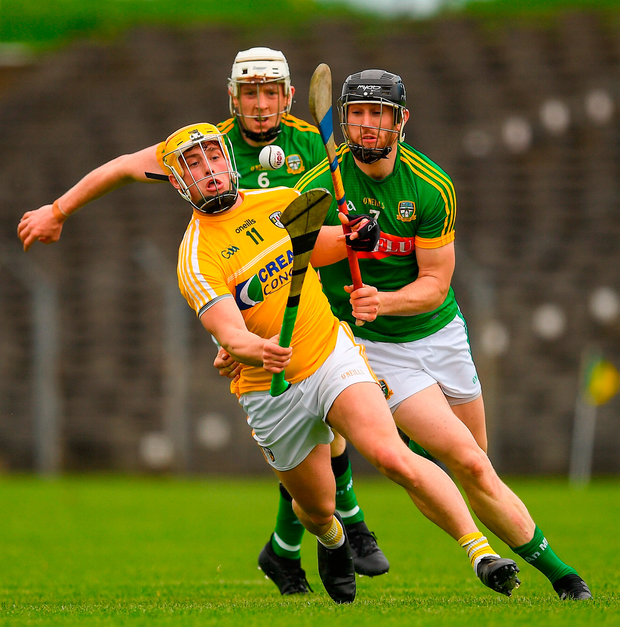 Antrim's Conor Johnston in action against Meath defenders Shane Brennan, right, and Damien Healy. Photo: Ray McManus/Sportsfile