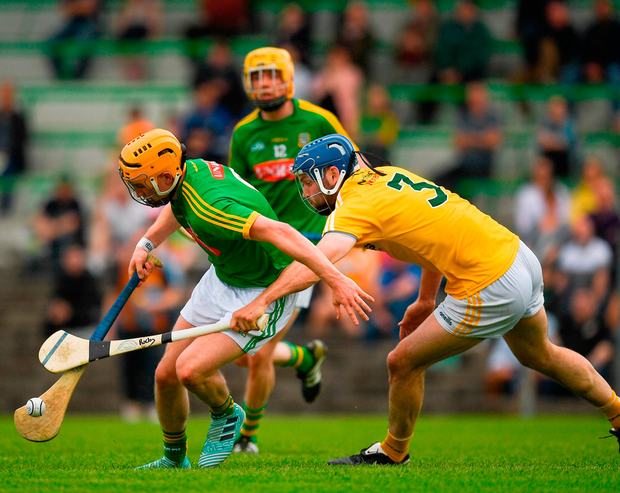 Meath's Adam Gannon battles with Antrim's John Dillon during the Joe McDonagh Cup Round 1 match. Photo: Ray McManus/Sportsfile