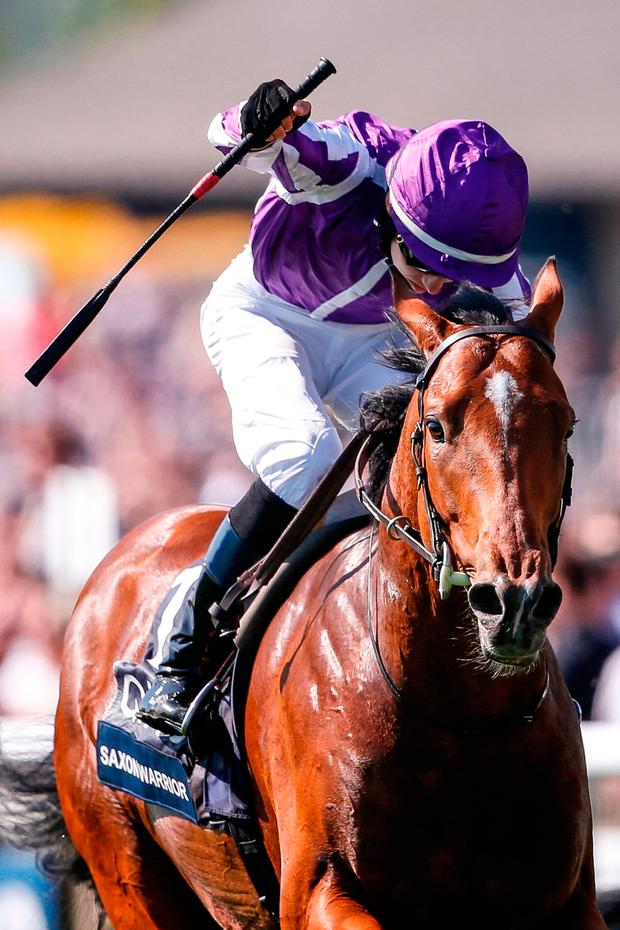 Donnacha O'Brien punches the air as Saxon Warrior passes the winning post after their victory in Saturday's English 2,000 Guineas at Newmarket. Photo: Alan Crowhurst/Getty Images